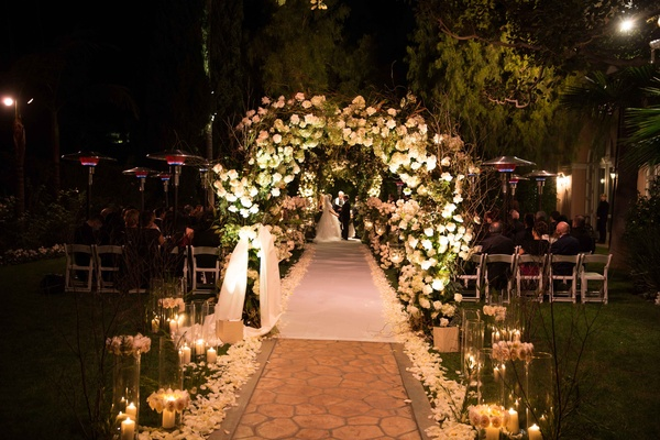 Fairy tale winter wedding with white amp gold dcor in beverly outdoor winter wedding at the beverly hills hotel with candles flower petals white aisle junglespirit Choice Image