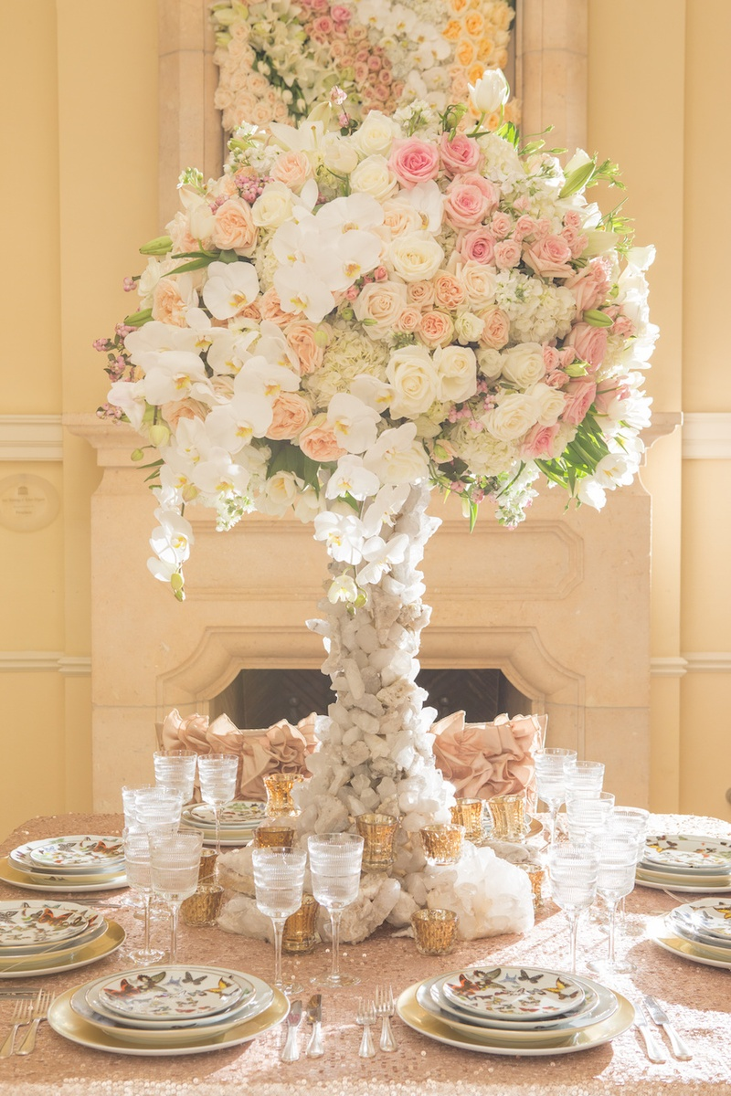 Wedding reception table with white pink
