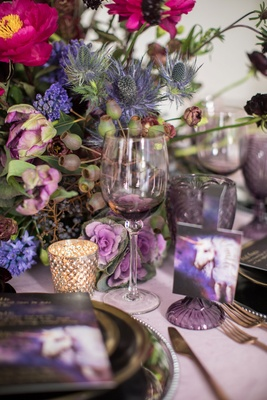 Wedding inspiration shoot purple unicorn design purple wine glass goblet with pink purple greenery