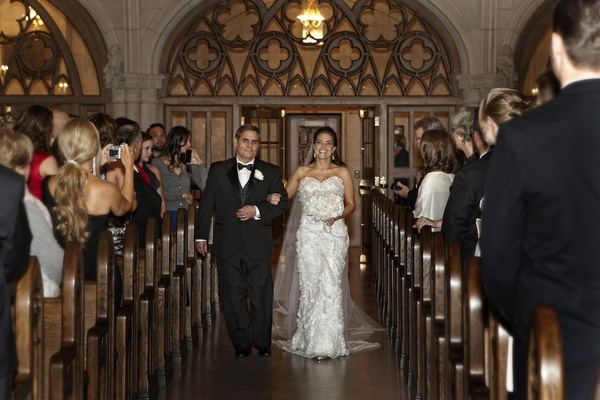 Father of bride walks bride down sanctuary aisle