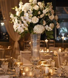 tall wedding reception centerpiece white hydrangea phalaenopsis orchid rose flower glass vase candle