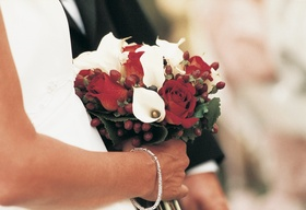 Wedding flowers featured white calla lily and red rose blooms