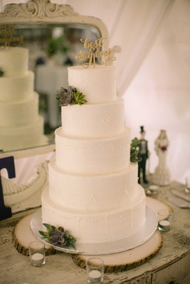 White wedding cake with fresh succulents and gold best day ever cake topper