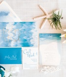 Bliss & Bone ocean inspired invitations with gold blue white calligraphy watercolor envelope liner