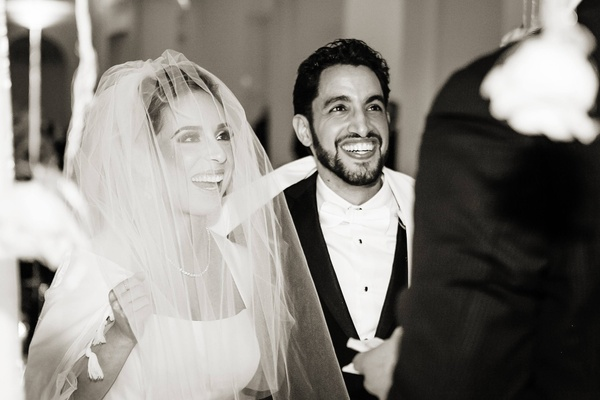 Black and white photo of bride and groom at Jewish wedding