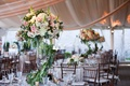 tall floral centerpieces inspired by secret garden featuring green foliage and white pink flowers