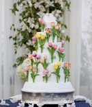 Sugar flower cake with colorful tulips and bird topper