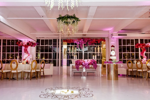 Wedding reception gold chairs pink purple fuchsia flowers white dance floor monogram flowers