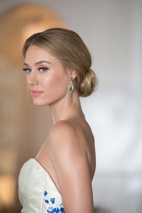 emerald drop earrings, southern-inspired wedding bride wearing updo strapless wedding dress