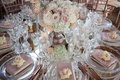 mirror wedding table with low centerpiece candleholders pink napkins fresh pink rose at each seat