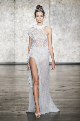 Inbal Dror Fall 2018 One-shoulder beaded lace gown with side drape feather trim and floral collar