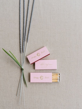 Wedding reception sparkler exit sparkler tied with greenery pink matchbox with matches gold monogram