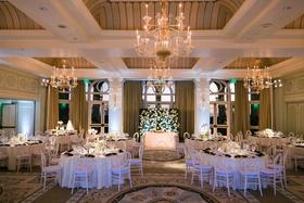 casa del mar wedding reception ballroom chandelier sweetheart table greenery white centerpieces