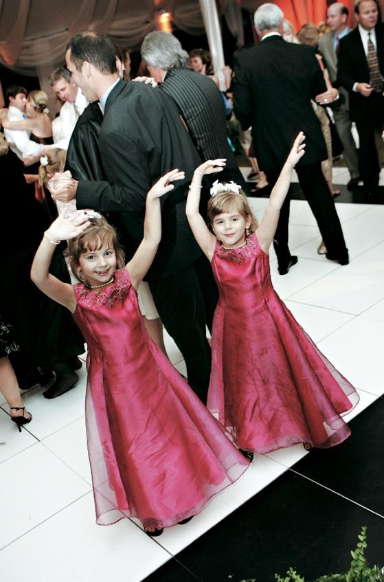 Cute girls in pink dresses on dance floor