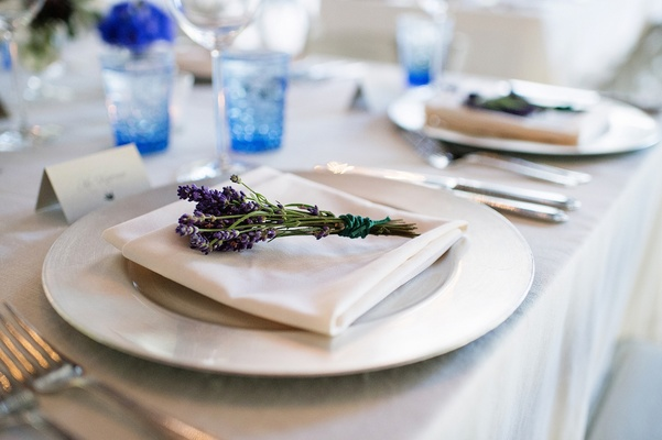 Wedding place setting with fresh sprigs of lavender herb