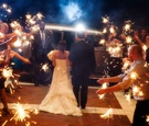 Bride and groom walk through sparkler exit