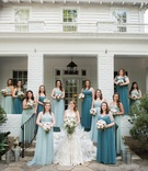 bride in mermaid lace gown, bridesmaids in teal, blue, and sea green convertible dresses