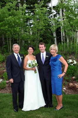 Bride and groom with father and mother of groom