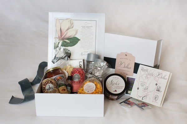 White welcome box filled with treats and personalized notes and snacks