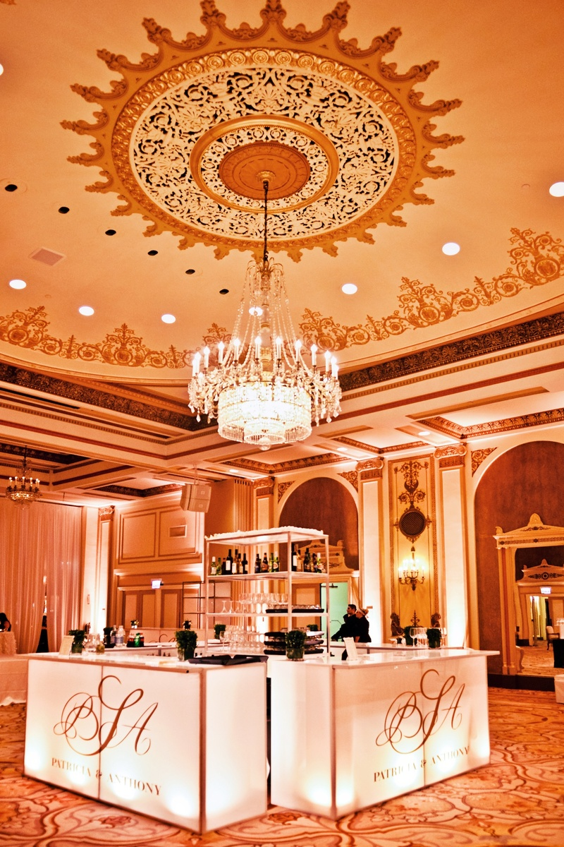 Chandelier over bar in center of the ballroom