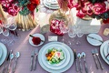 fresh salad pink table linen white china gold vases red and purple floral arrangements rustic