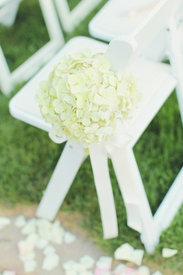 Ivory hydrangeas attached to white wooden chair