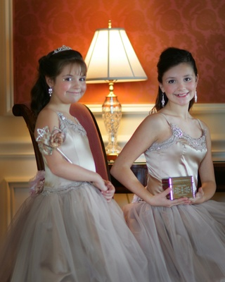 Flower girls with sparkly dresses with tulle skirts and wand