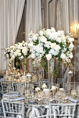 Silver table linens and chairs with large centerpiece