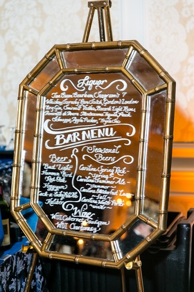 Gold bamboo mirror with white ink bar and liquor drink list