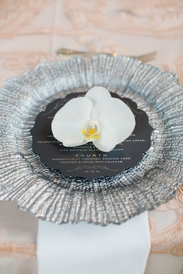 Wedding reception silver charger plate round menu card white phalaenopsis orchid