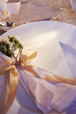 White charger plate with menu letterpress white napkin gold ribbon white privet berries