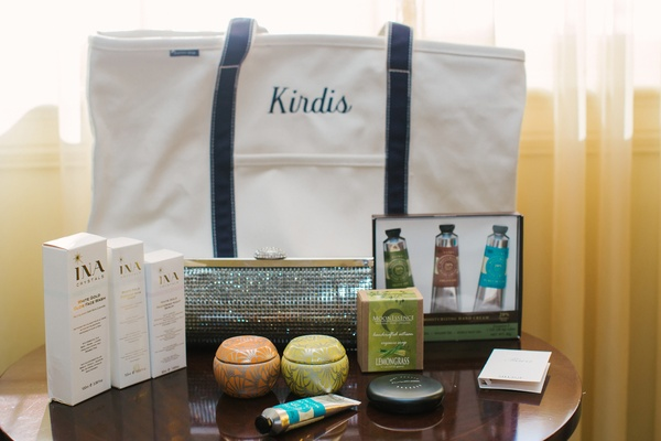 Embroidered tote bag with beauty products and crystal clutch