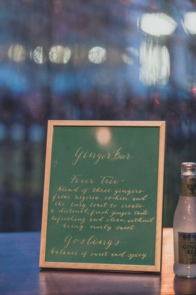 wedding reception cocktail hour green menu in gold frame gilt calligraphy ginger beer