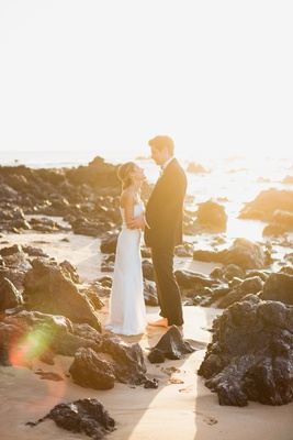 bride in j. mendel wedding dress, groom in ralph lauren purple label suit, golden hour portrait maui