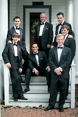 groom and groomsmen wear classic black tuxedos