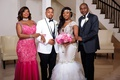 wedding photo of bride and groom with mother and father mother in hot pink dress with choker