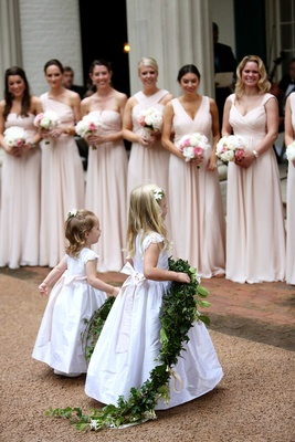 pink bridesmaids dresses, flower girls in white dresses