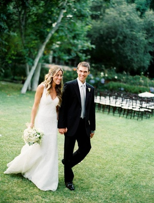 Bride in a Monique Lhuillier gown and groom in a black tuxedo with light grey tie