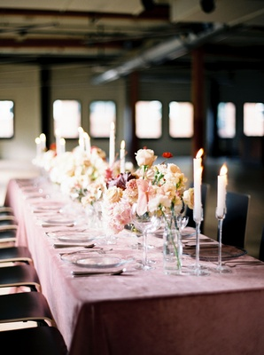 Wedding reception pink velvet linens with tall candleholders taper candles velvety clear plates
