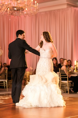 bride in allure couture trumpet gown with beading and ruffles, groom in tuxedo, choreographed dance