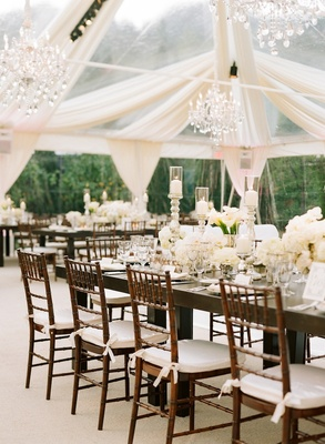 Wood reception tables with white flower centerpieces