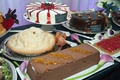 Chocolate cake, pie, cream cake, and tart at wedding reception