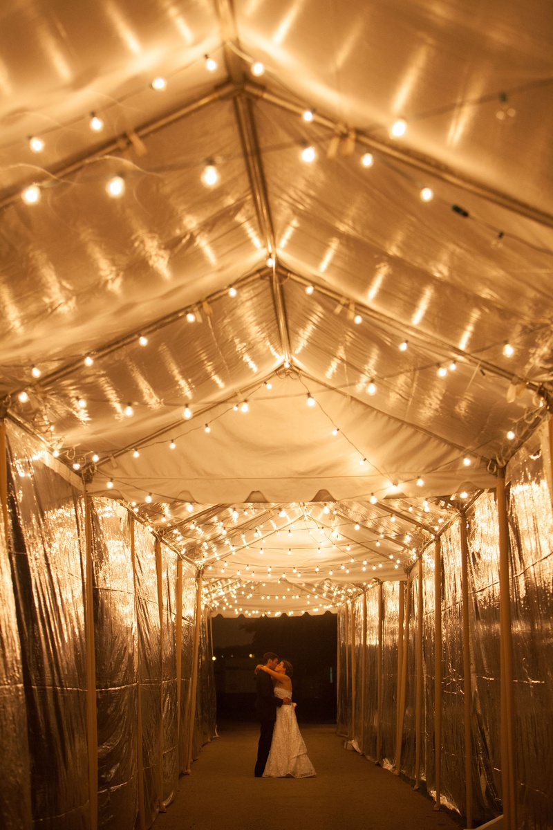 cool couple portrait bright lighting at night tunnel tent wedding string lights & Reception Décor Photos - Glowing String Lights at Reception ...