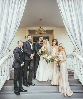 small bridal party with two bridesmaids and two groomsmen, bride in stella york wedding dress