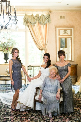 Bride with sister, mother, and grandmother in vintage gowns