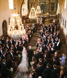Our Lady of Mount Carmel Catholic Church in Montecito wedding with chandeliers over aisle