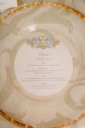 wedding reception place setting gold rim charger plate round menu card gold blue design motif