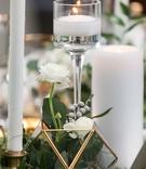 brunia berries, white flowers, greenery in gold edge geometric terrarium, various candles
