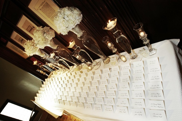 Table with white seating cards and linens