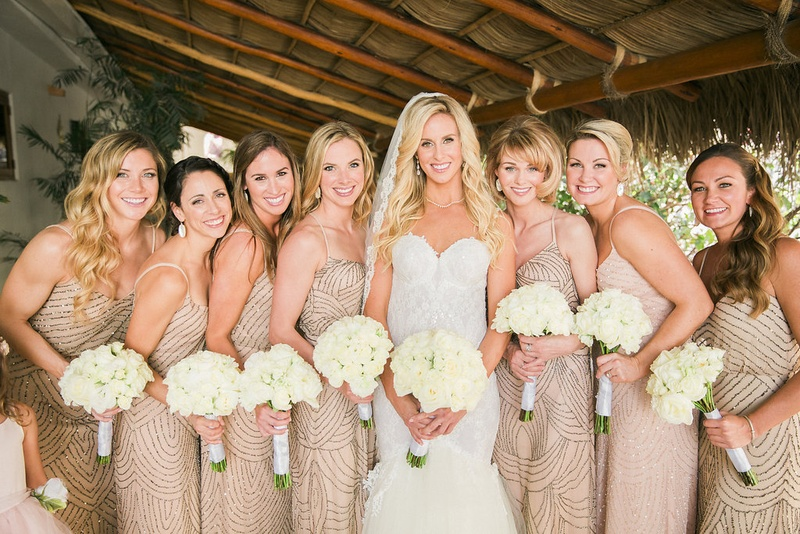 bride white trumpet gown her bridesmaids in champagne colored dresses bead embellishments straps